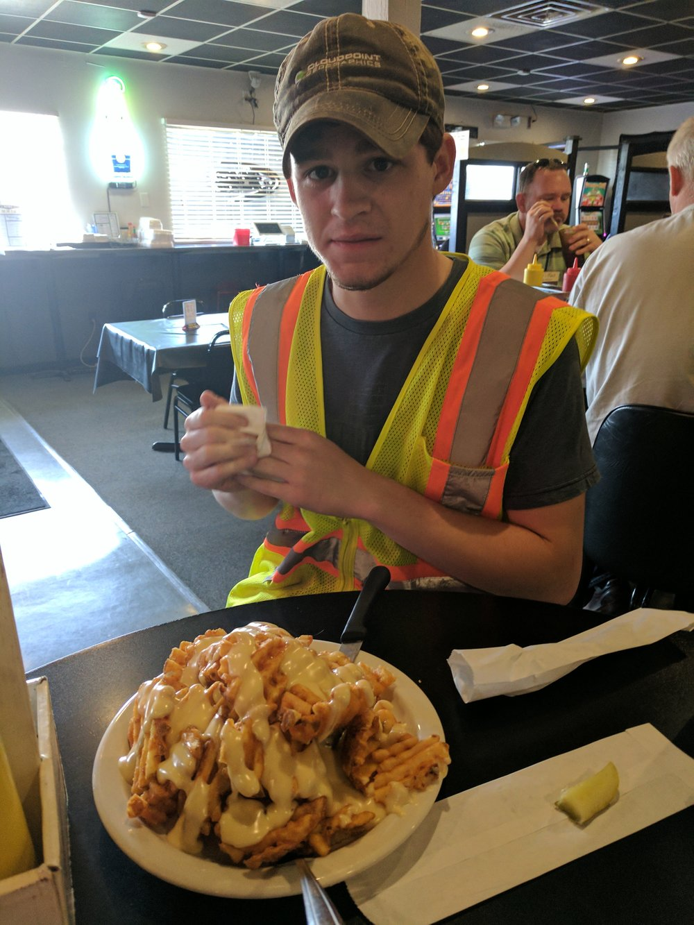 While at Macon County we frequented several local eateries for lunch. One of our absolute favorites was Pop's Place. Tyler is seen here with his favorite order; the hosreshoe with white cheese sauce.