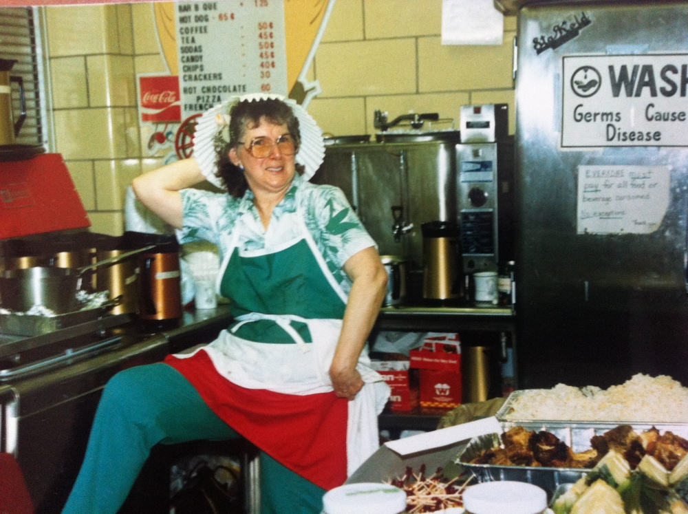 Loretta, catering at the annual St. Francis of Assisi Luau, around 1991-2