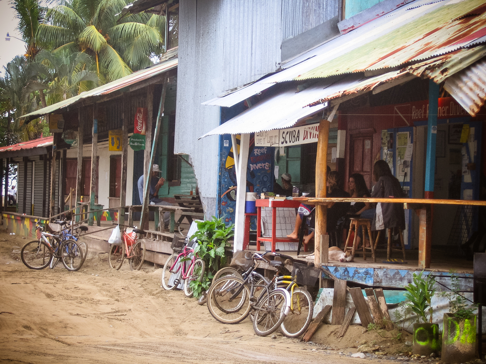 Cool surf shacks and shops line the beach near Playa del Centro in Puerto Viejo town