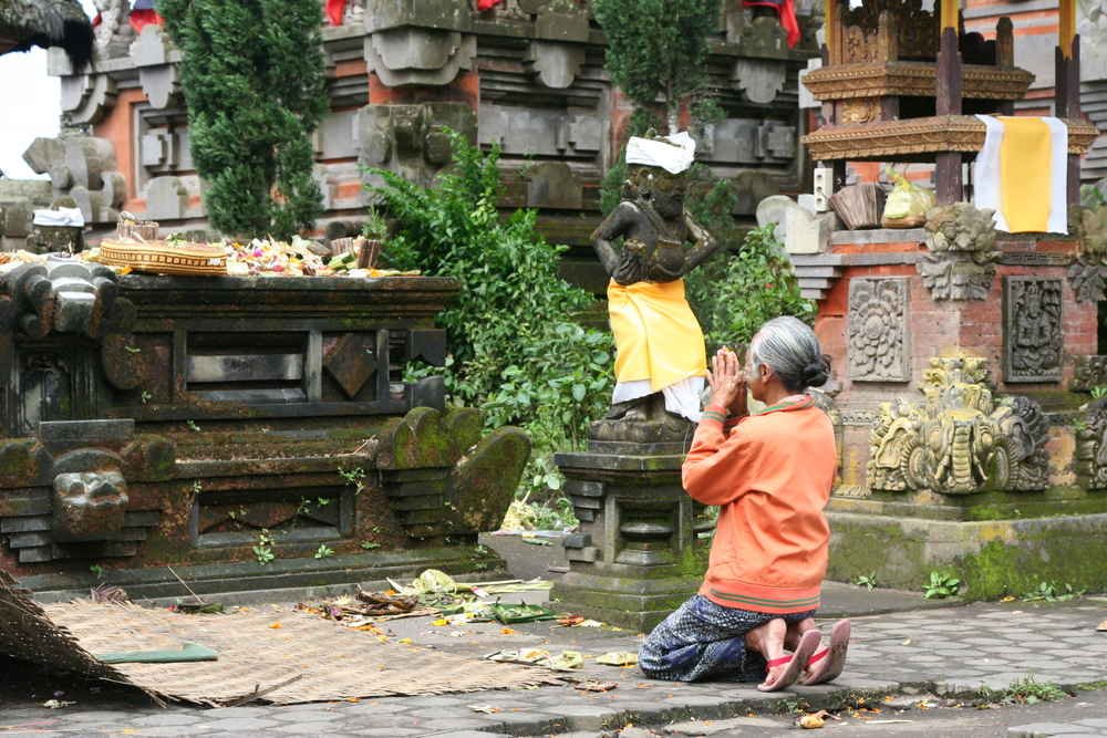 A quiet moment for blessings, in Bali