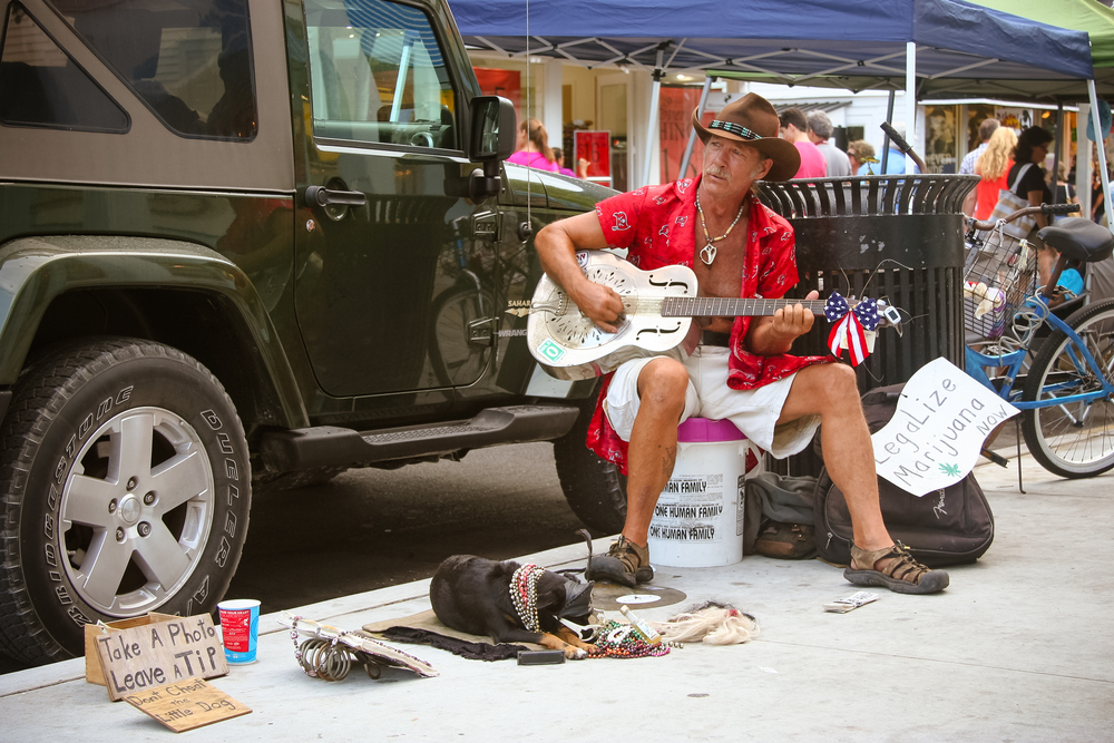 MEET COWBOY GEORGE  George has been performing on the streets of Key West for nearly 20 years, his trusty, furry companion King Coconut by his side.