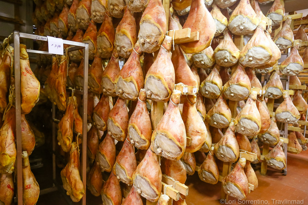 Aging hams hang for an additional 11 months after processing