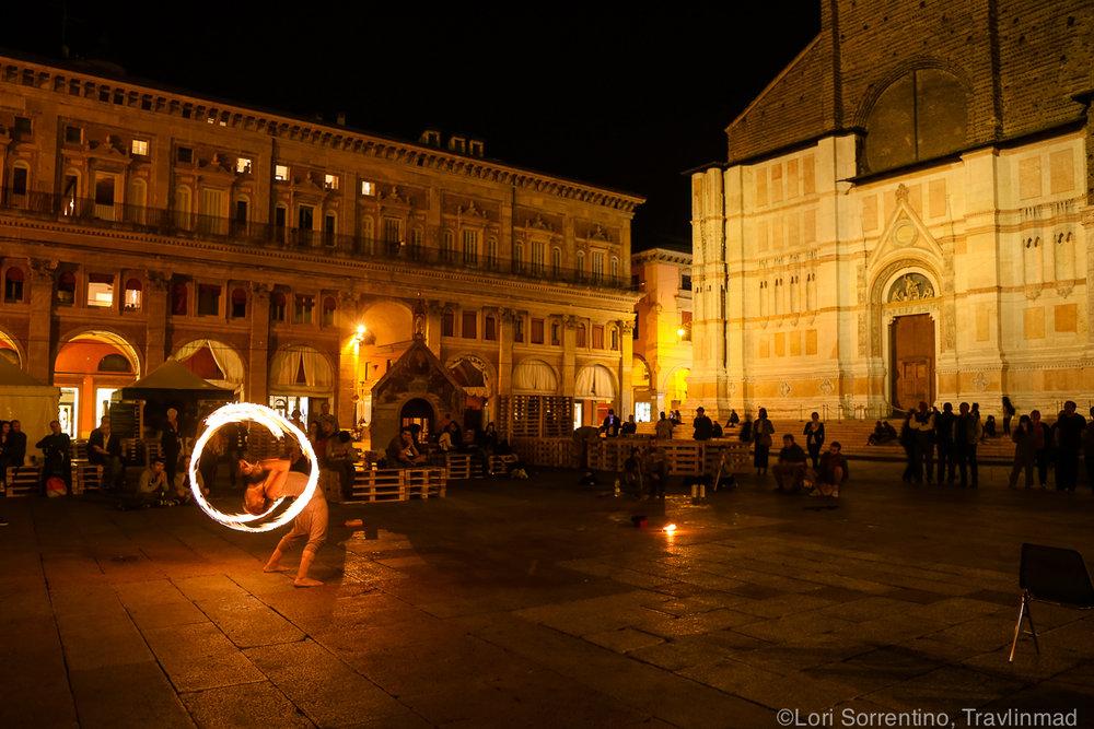 Fire dancer, Piazza Maggiore, Bologna, Italy
