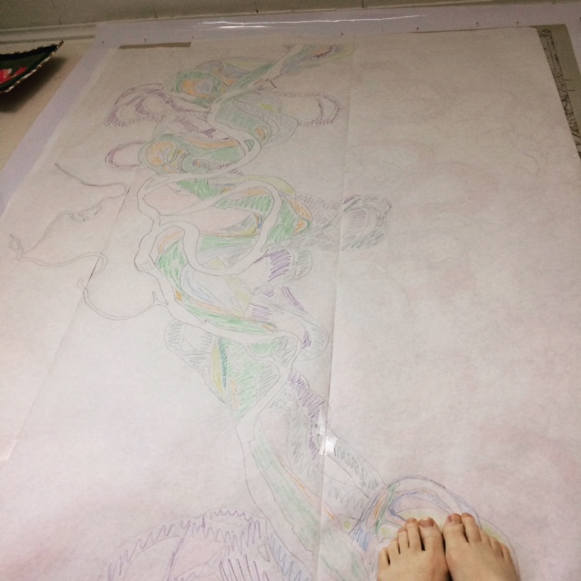 Here I am taking a break while lying on the floor with my head under my work table, looking up at my pencil drawings. My ugly feet are there for scale.