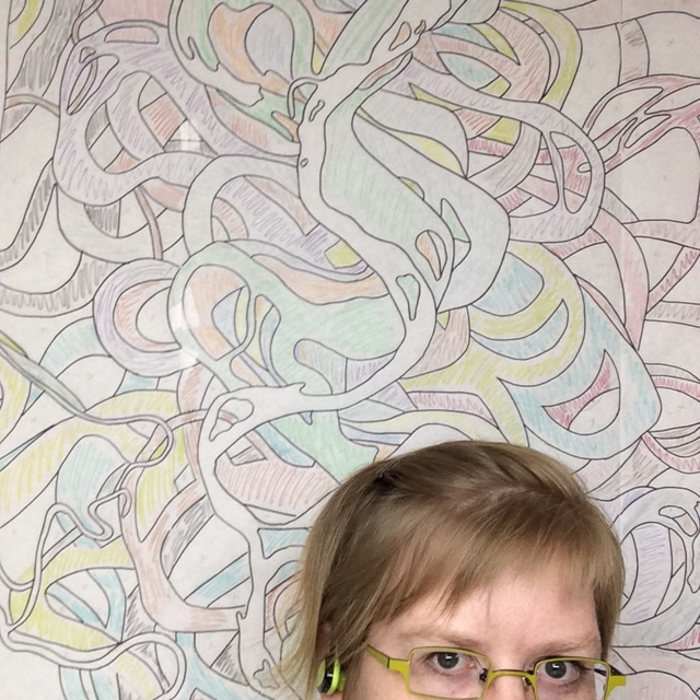 Paper pattern hanging on the design wall. My head is for scale. You know I was working hard because my hair is pinned back.