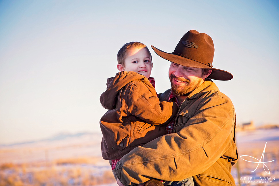 One of my favorites! Dad with awesome hat carrying his son. What could be better.
