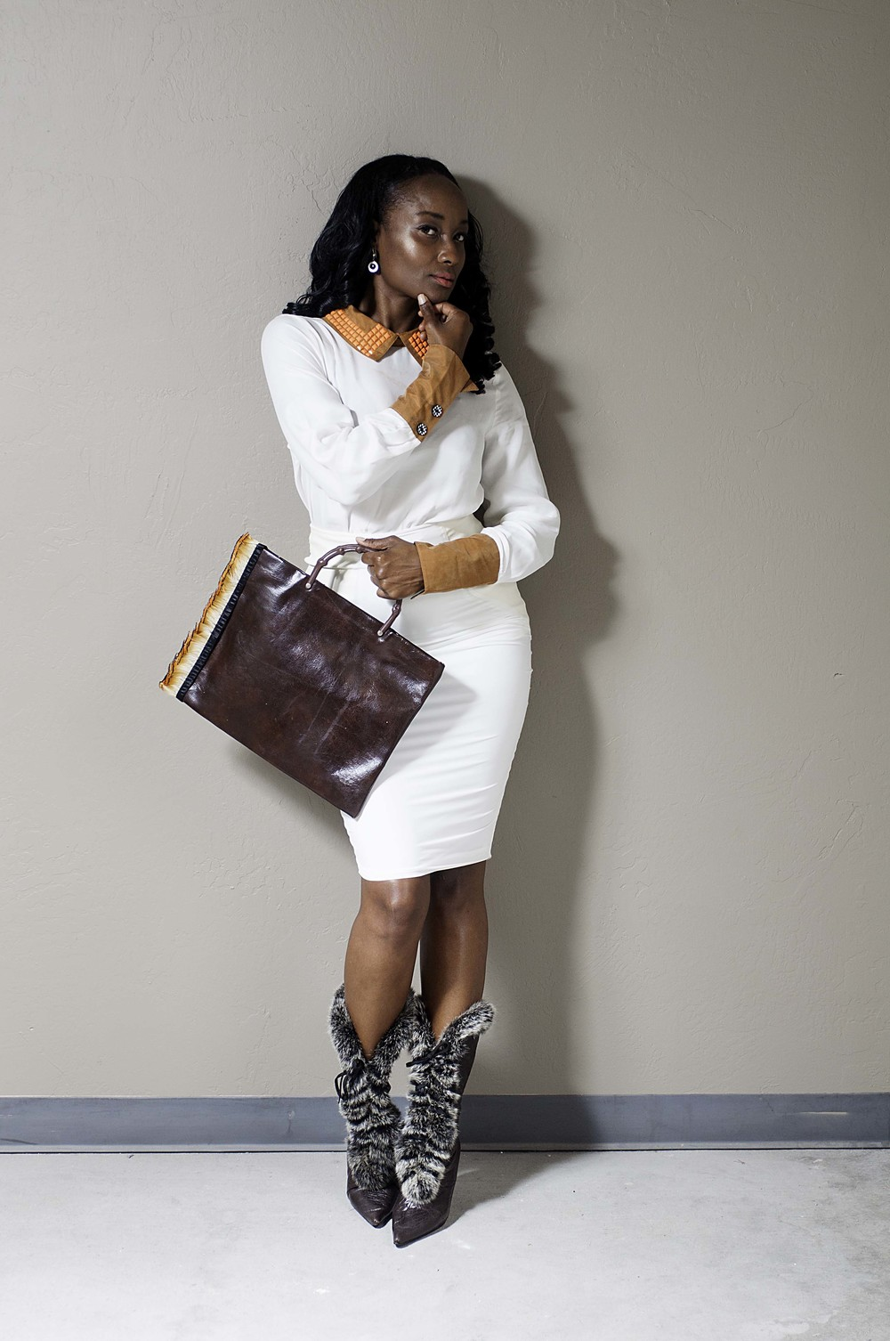 """Wila"" the blouse $105. ""Anna"" the skirt $159. ""Boardroom Bombshell"",  SHOP  the Look."