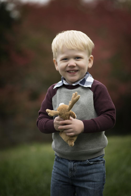 little blond boy holding stuffed reindeer Springfield VA Childrens Photographer kate Montaner