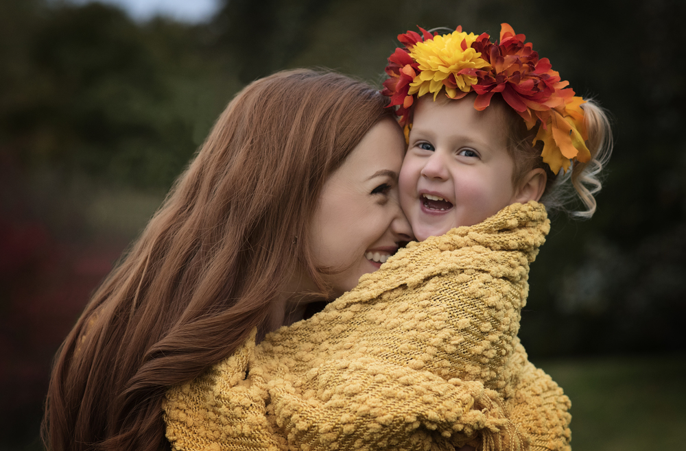 Mother with daughter wrapped in blanket wearing autumn crown Kate Montaner Lifestyle Photography Bristow Virginia