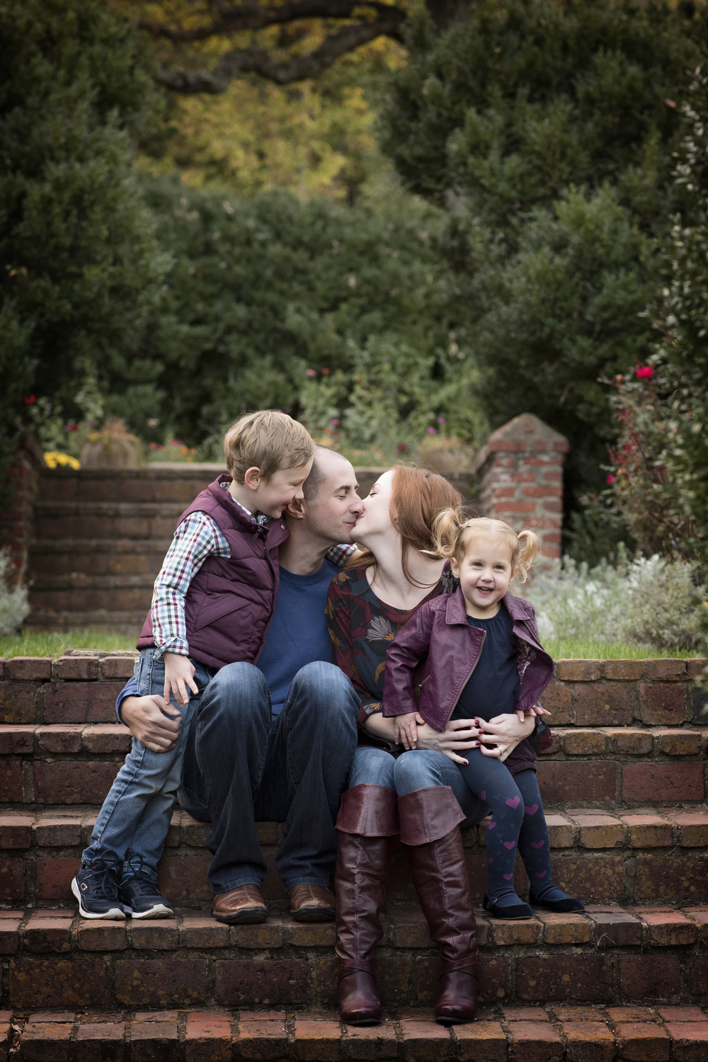 family laughing together on brick steps Lifestyle Photography Kate Montaner Photography
