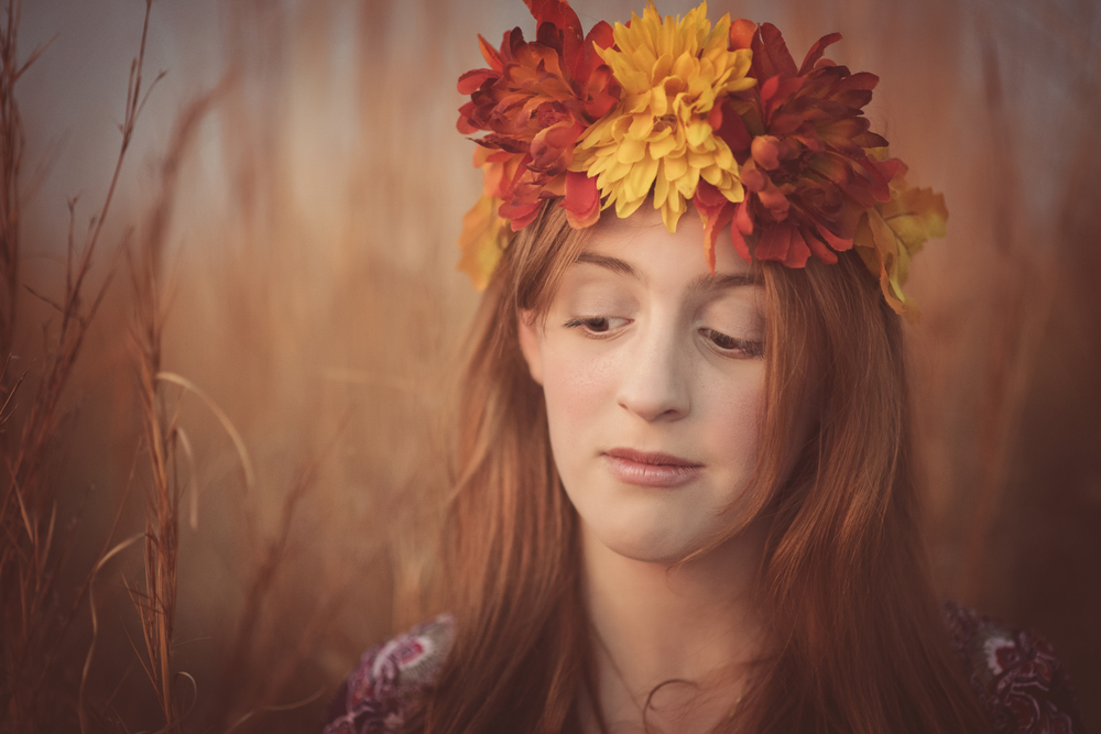 Ethereal young redhead girl in field with autumnal flower wreath Fine Art Portrait Photography Kate Montaner Photography