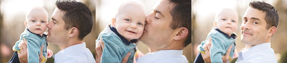 Spring-blossom-father-kisses-baby-son-session-northern-virginia-premium-portrait-photographer-kate-montaner-photography