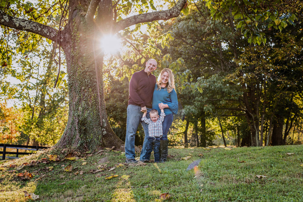 Fall Family Portraits with beautiful sunburst and sunflare by  Kate Montaner Photography (4).jpg