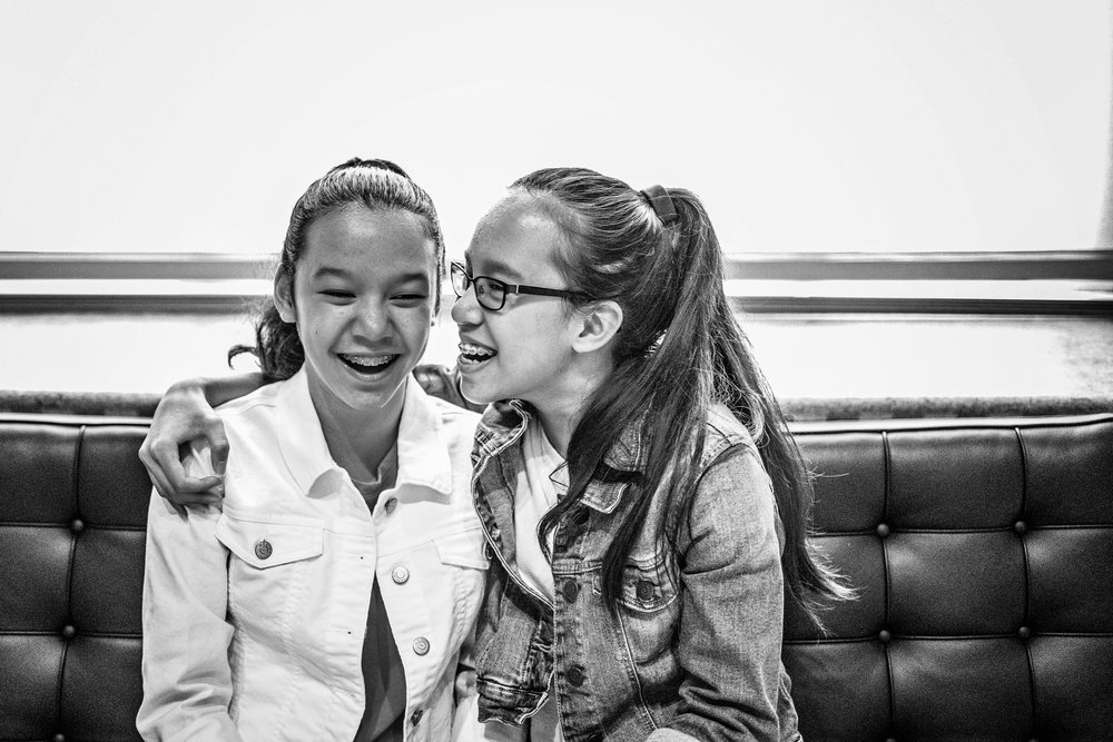 Twin Teen Sisters share a candid laugh at the National Portrait Gallery Washington DC Family and Childrens Black and White Photographer Kate Montaner Photography (5).jpg