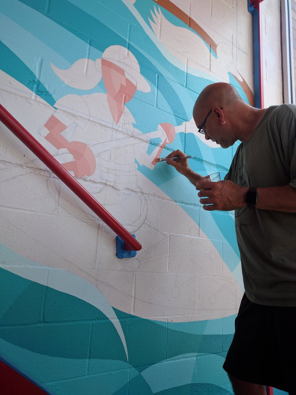 Valley meticulously fills in the details on the New Castle mural.