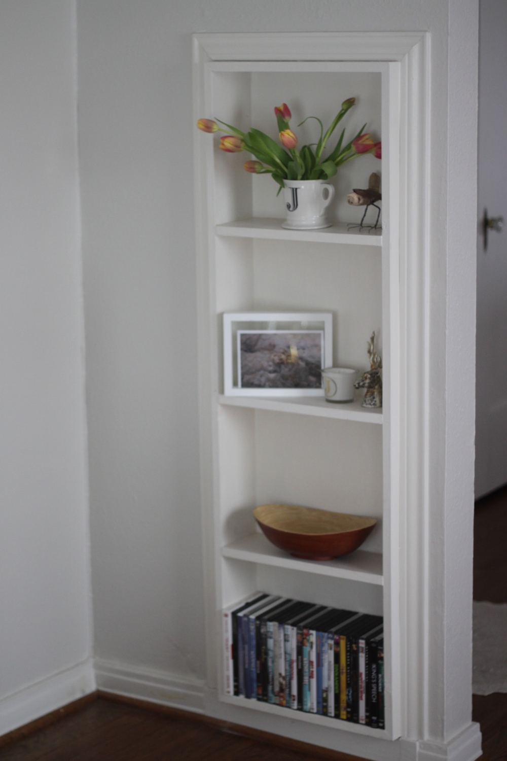 We love the built-ins this home has. Perfect for all of our knick knacks &fresh tulipsyour aunt gives you for a housewarming gift :)