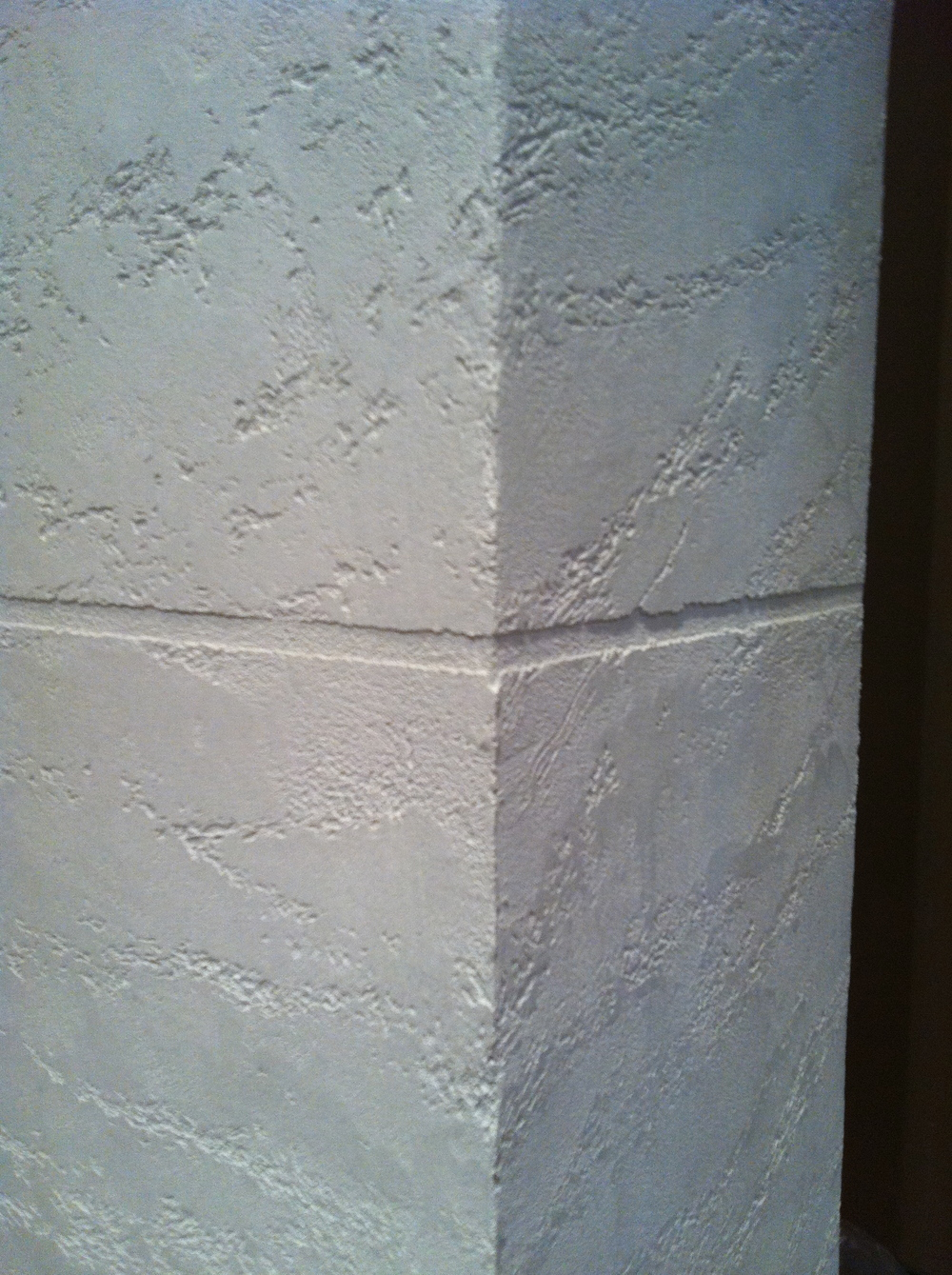 Corner close up brick effect special textured paint for Travertino romano