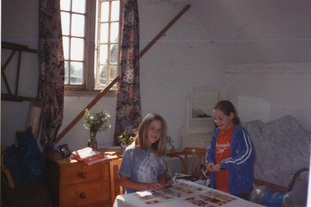 My sister in the apple room, when we briefly turned it into a den (until we cleared it out you could barely open the door, it was so full of old furniture and junk).
