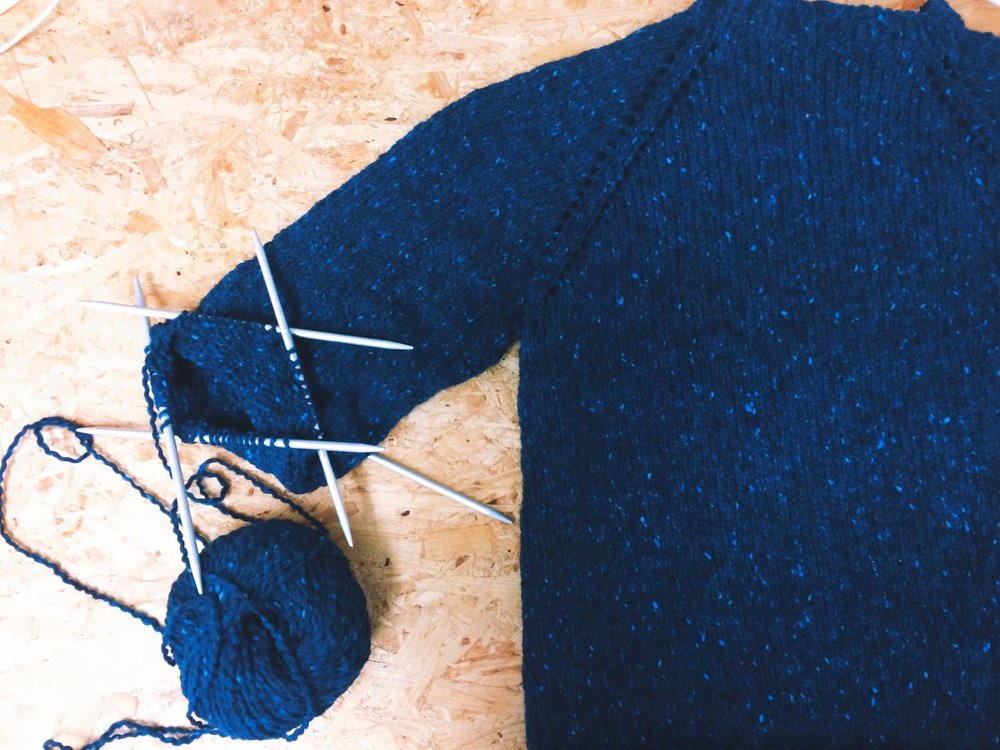 close-up-of-ball-of-wool-with-knitting-needles-and-sweater-533789933-57c740973df78c71b61647c7.jpg