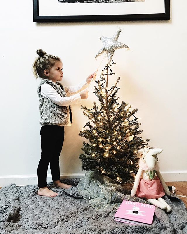 Putting those final touches on the tree! There's so much renewed magic and spirit in the holidays with two kiddos around now and I absolutely love every minute of it! #parkermae #throwbackpic #christmasiscoming🎄