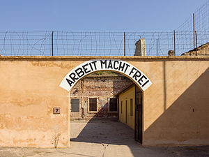 "Entrance at the inner camp of Terezin.  ""Arbeit macht frei"" means ""Works frees."""