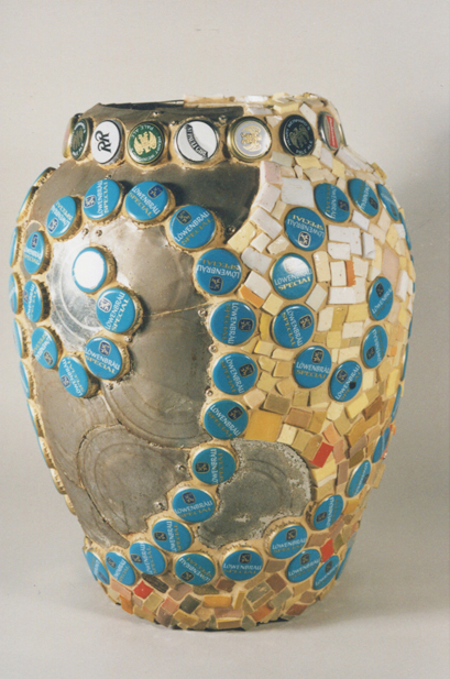 "Two Faced, 12""x20""x12"", ceramic vase, bottle caps, tin cans, glass tiles, 2007"