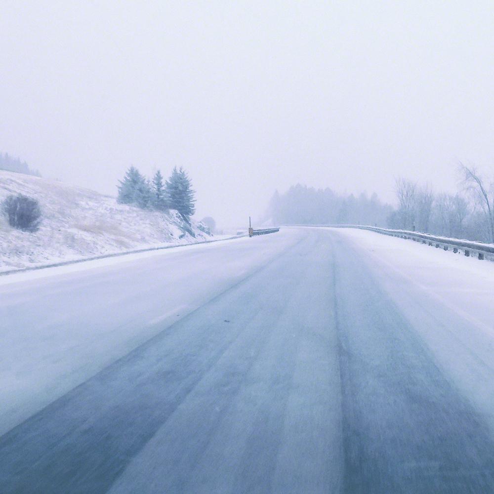 Empty, snowy highway
