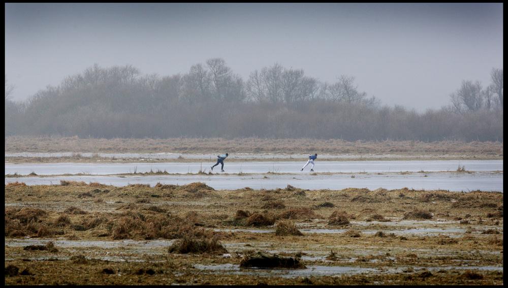 Serious Fen skaters enjoy a secret piece of natural ice, Sutton, Cambridgeshire