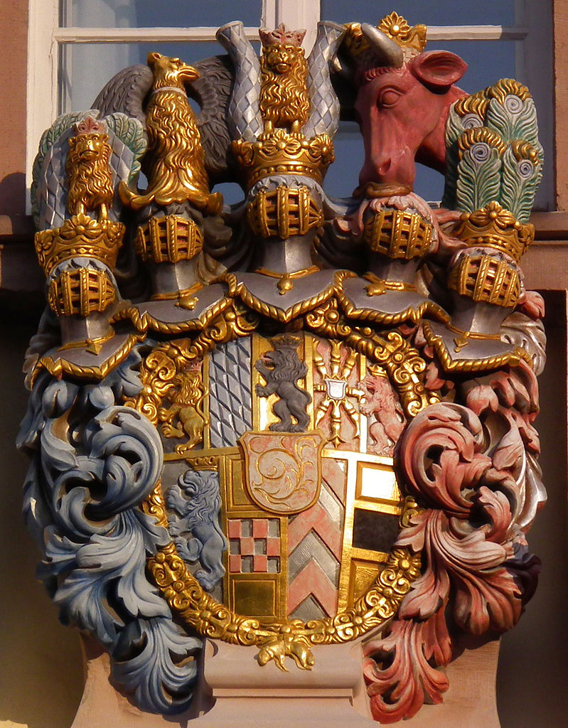 Heidelberg detail (Coat of Arms) Present coat of arms is a copy of the original by Heinrich Charrasky For a reading of the symbolism, click here: http://www.dr-bernhard-peter.de/Heraldik/Galerien/galerie1021.htm