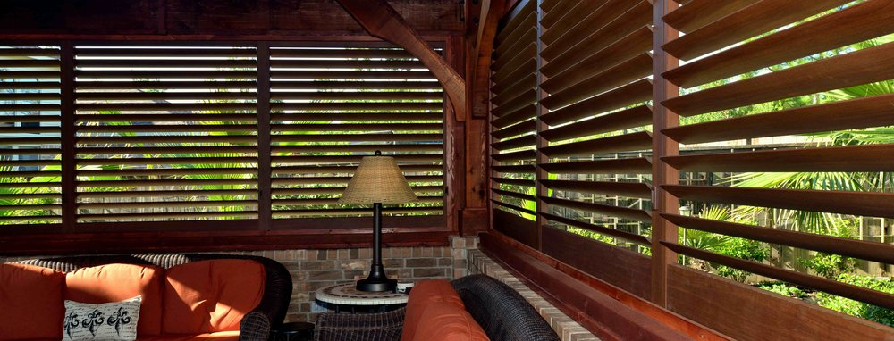 Fixed Walnut Aluminum Shutters.jpg