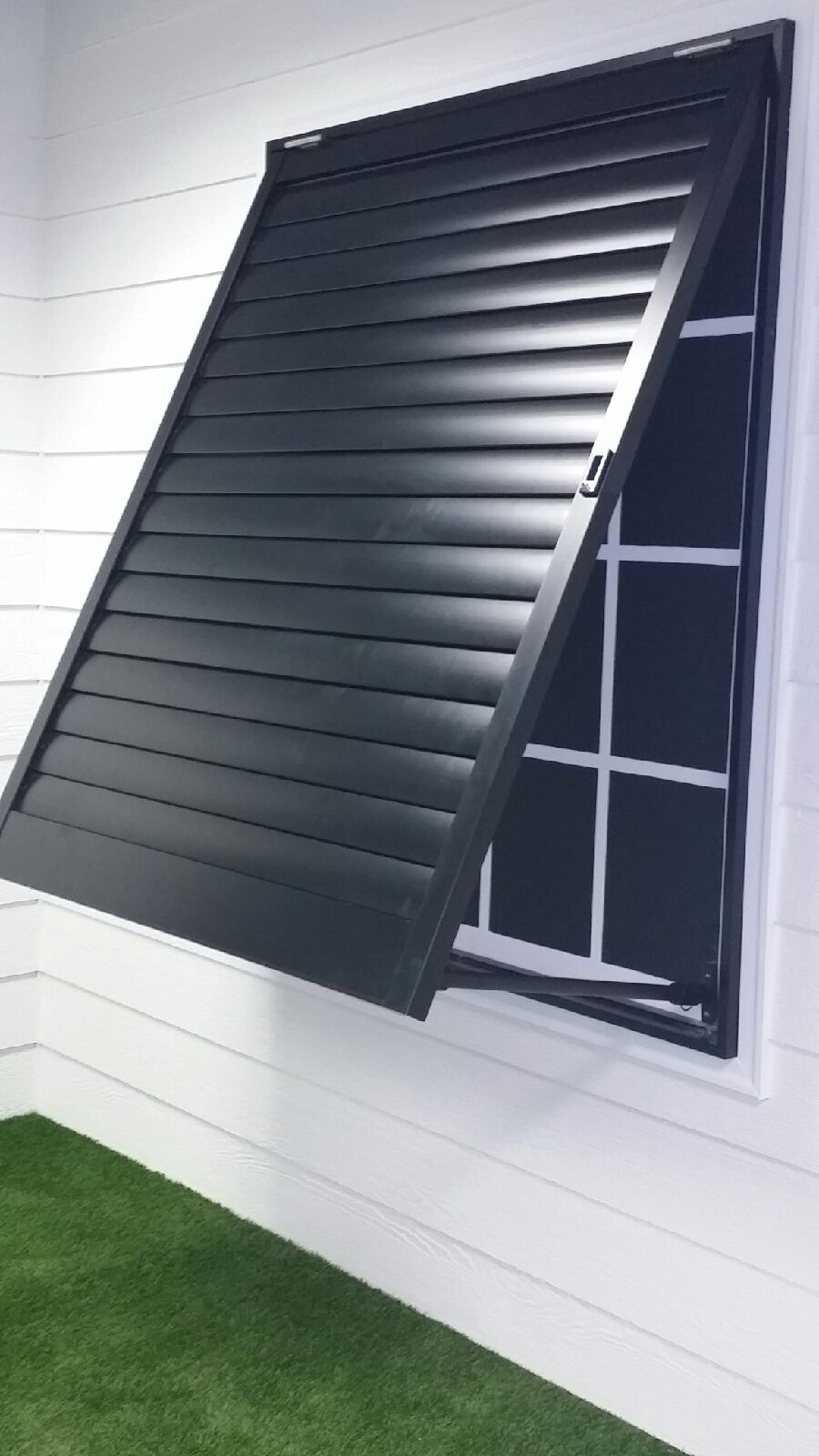 Weatherwell Elite Black Aluminum Bahama Shutters.jpeg