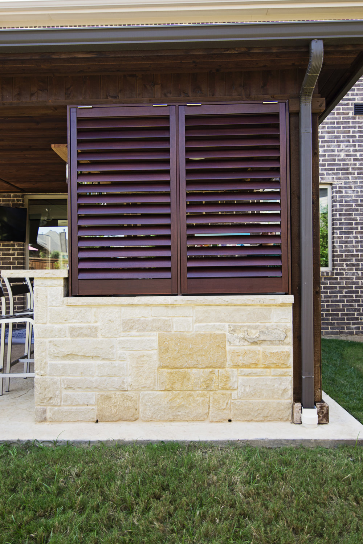 Weatherwell Elite Walnut bahama shutters.jpg