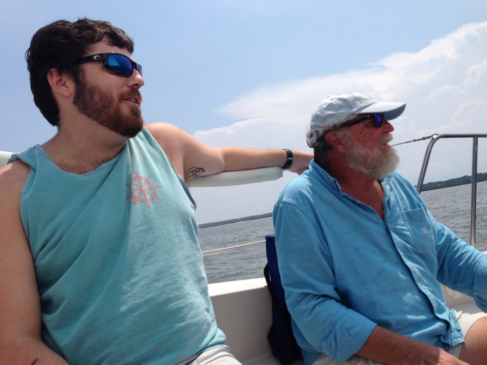 """My son, Hans and husband Olin, sailing on the """"Peconic Tonic"""" . I married into a sailing family and that is apparent in my subject matter. When I am not painting I am usually out on our sailboat or motorboat taking photo's and enjoying the good life."""