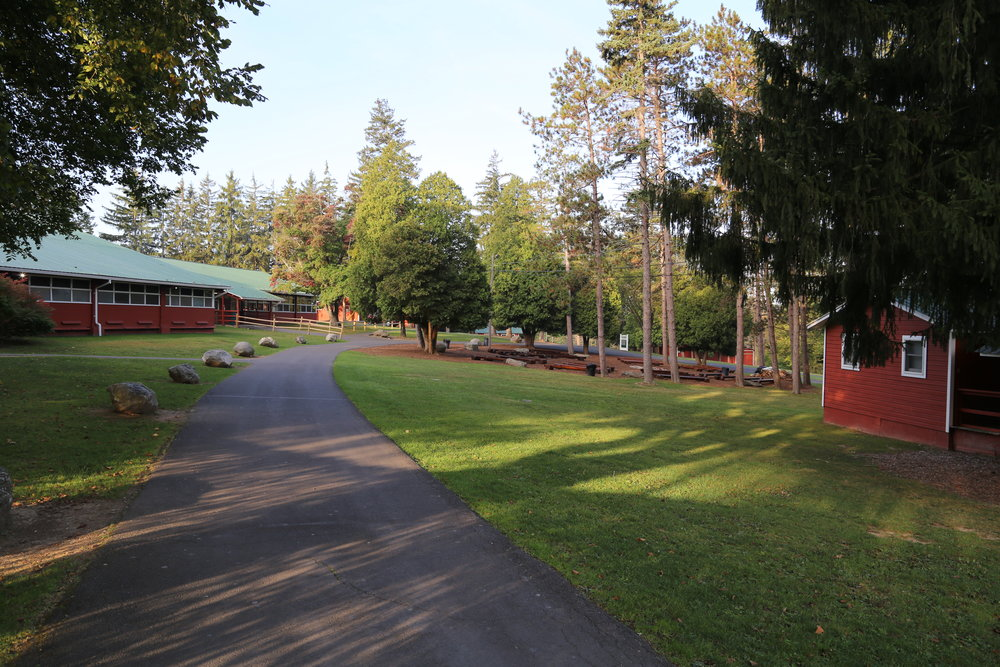 CABINs, campfire area, and dining hall at The Beautiful Pocono Valley Resort