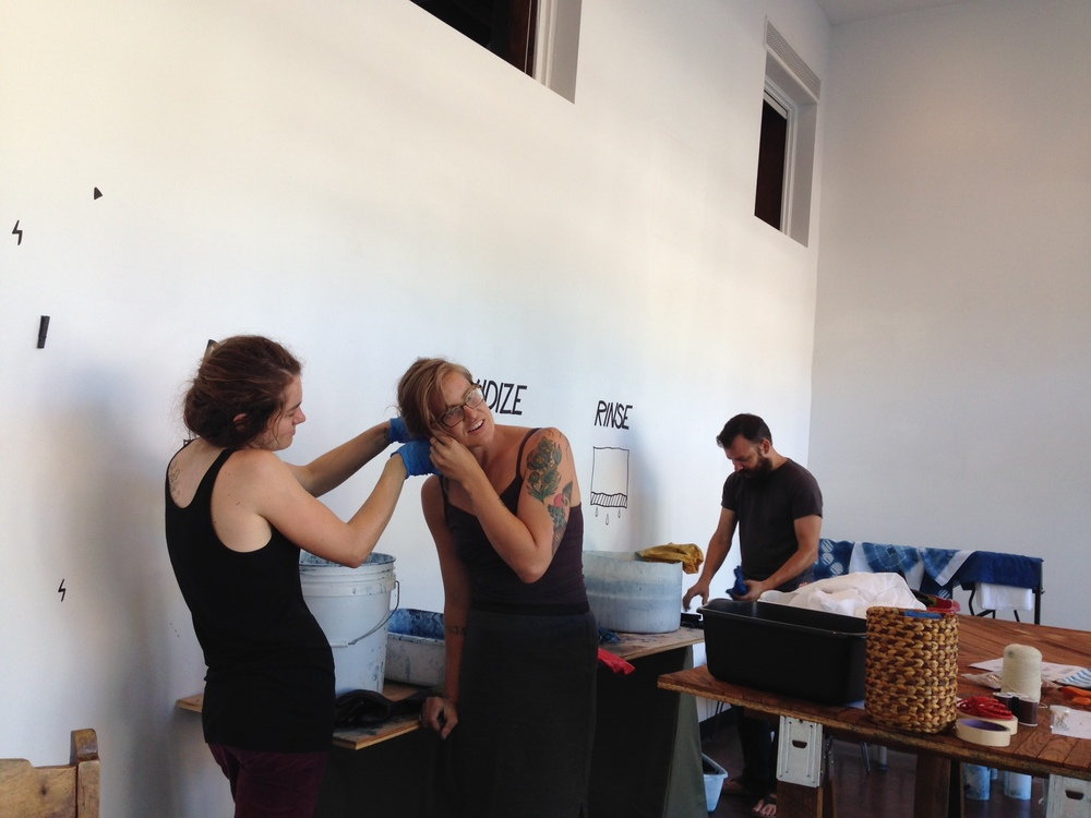 Kelsey dying Carly's hair with indigo at the workshop in July  (it's still blue!)