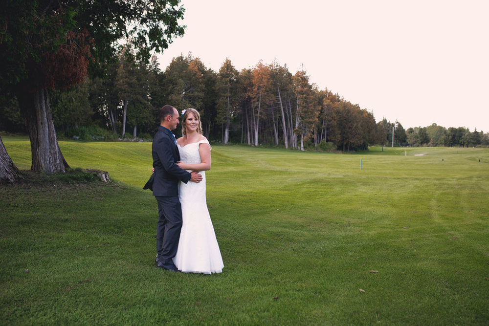 Sand Point Golf Course Wedding in Arnprior by Ottawa Wedding Photographer Joey Rudd Photography Bride and Groom Green
