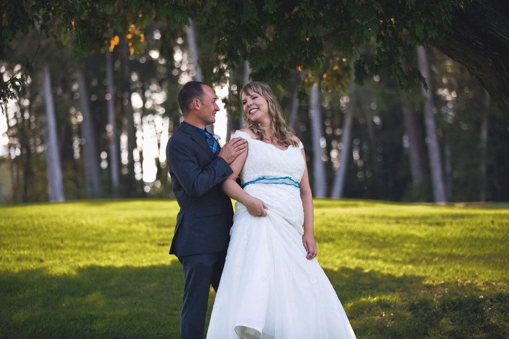 Sand Point Golf Course Wedding in Arnprior by Ottawa Wedding Photographer Joey Rudd Photography Bride and Groom Pose