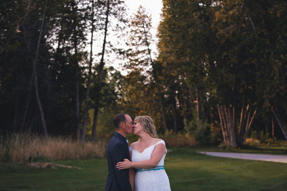 Sand Point Golf Course Wedding in Arnprior by Ottawa Wedding Photographer Joey Rudd Photography Bride and Groom Trees