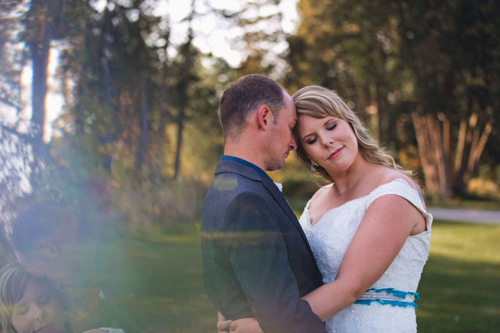 Sand Point Golf Course Wedding in Arnprior by Ottawa Wedding Photographer Joey Rudd Photography Bride and Groom Prism