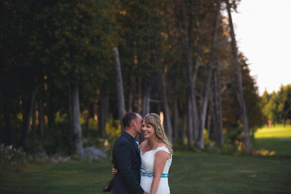 Sand Point Golf Course Wedding in Arnprior by Ottawa Wedding Photographer Joey Rudd Photography Bride and Groom Golden Hour Pose