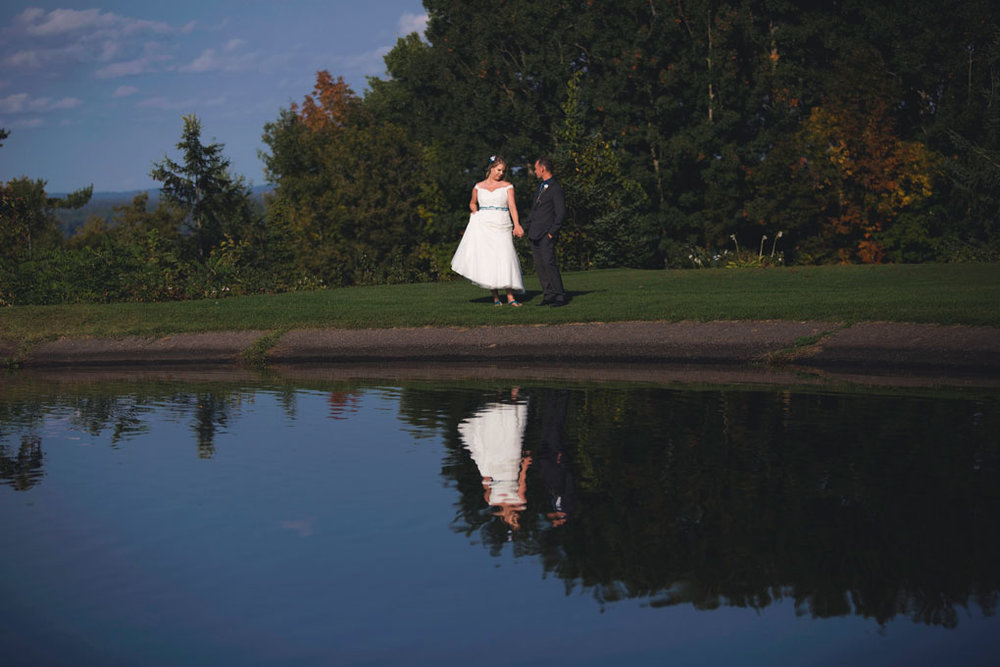 Sand Point Golf Course Wedding in Arnprior by Ottawa Wedding Photographer Joey Rudd Photography Bride and Groom Reflection