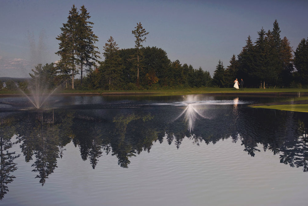 Sand Point Golf Course Wedding in Arnprior by Ottawa Wedding Photographer Joey Rudd Photography Bride and Groom Fountain