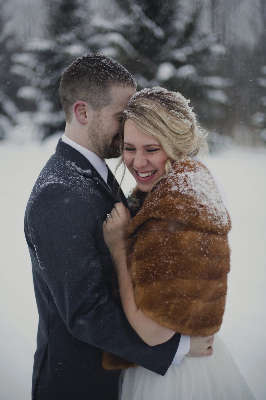 Winter Wedding in Ottawa at Greyhawk Golf Club by Ottawa Wedding Photographer Joey Rudd Photography Snow Bride and Groom