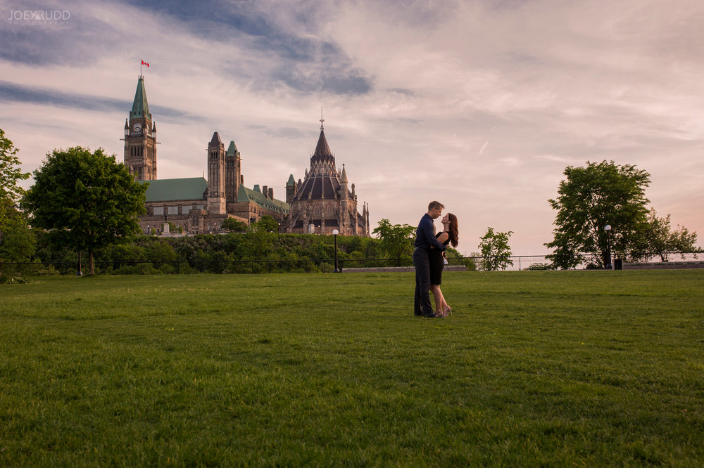 Engagement Photos, Ottawa Photographer, Ottawa Wedding, Ottawa Wedding photographer, downtown ottawa, chateau laurier, light leaks, fun, happy, enaged, photographer, joey rudd photography, lightsabers, star wars, unique, water, sunset, parliament