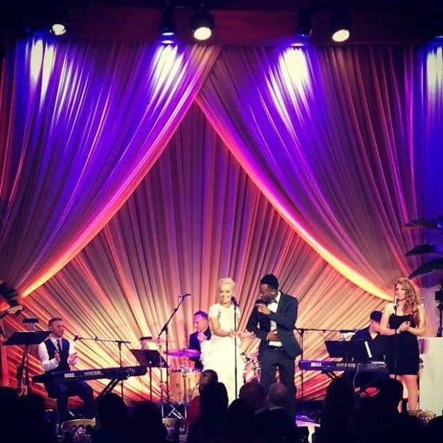Singing with Rita Ora at Harvey Weinstein's Oscar Party before performing at the Academy Awards.