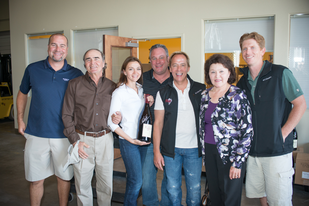 Pictured left to right: Dan Kosta,  Vadim, Diana Karren (holding a double magnum of a 2010 Kosta Browne Terra de Promissio), Michael Browne, David Hejl, Sonia, Chris Costello