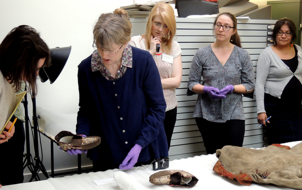 Examining the PRM moccasins. From left to right: Sara Komarnisky, Laura Peers, Katie Pollock, Naomi Bergmans, and Judy Half.