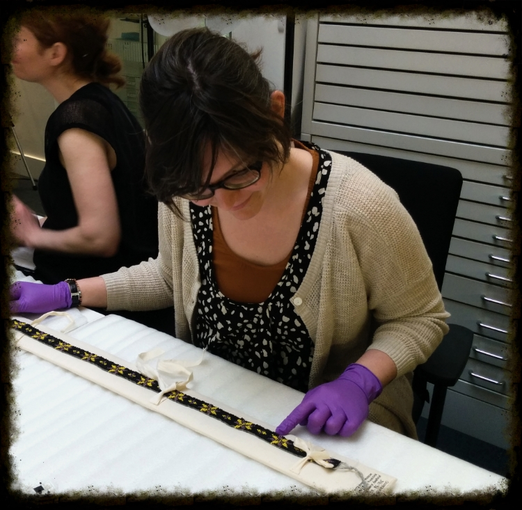Sara Komarnisky counting the beads on the beaded belt