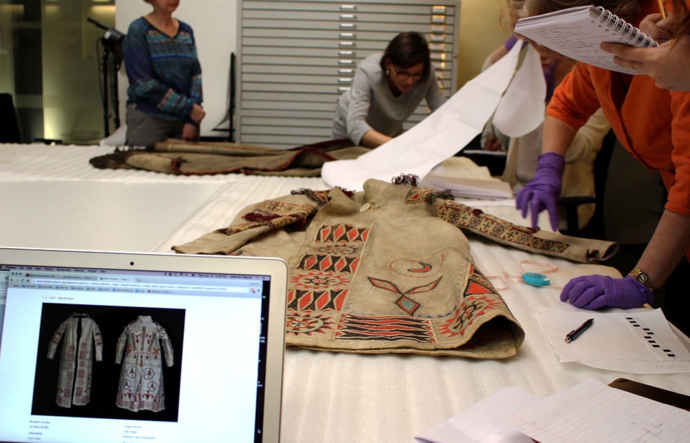 Comparing the  Metis Coat 1951.2.19  from the Pitt Rivers Museum with the  British Museum Coat . The image on the computer screen of the British Museum coat is courtesy of the © Trustees of the British Museum.