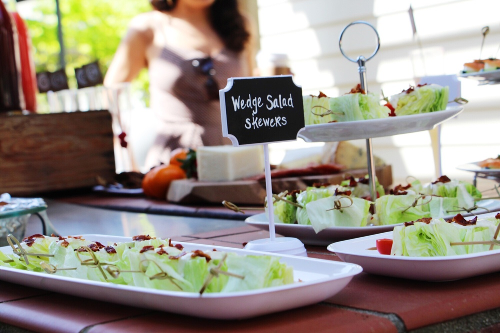 Wedge salad skewers with blue cheese dressing and freshly prepared Natural Sunday Bacon crumbles.